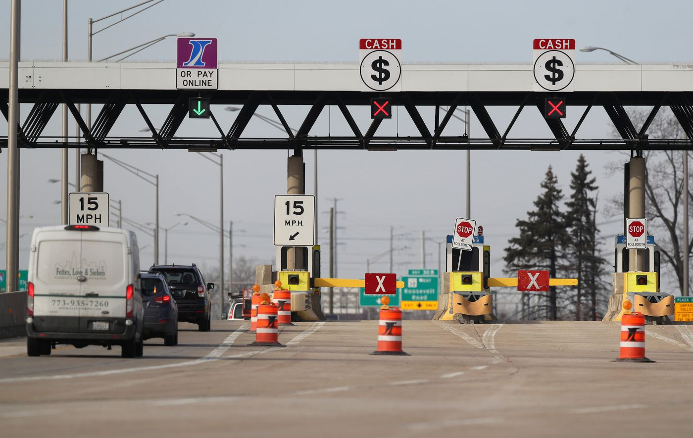 Drivers pass through an I-Pass lane near closed cash lanes at the Cermak Road toll plaza on I-294, Feb. 26, 2021.