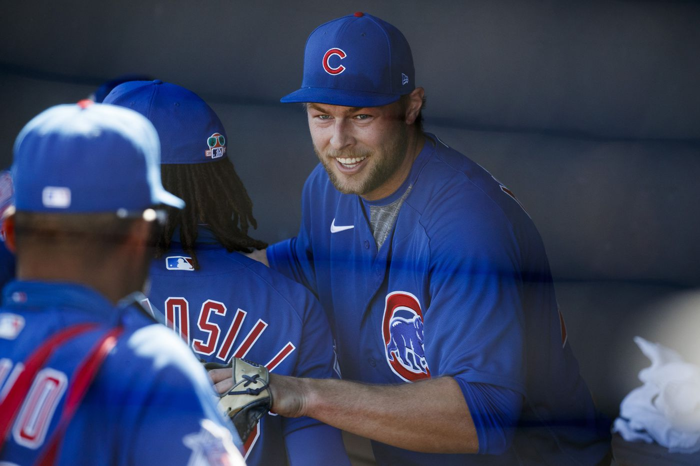 Cubs pitcher Trevor Megill smiles after the Cubs defeated the Padres 1-0.