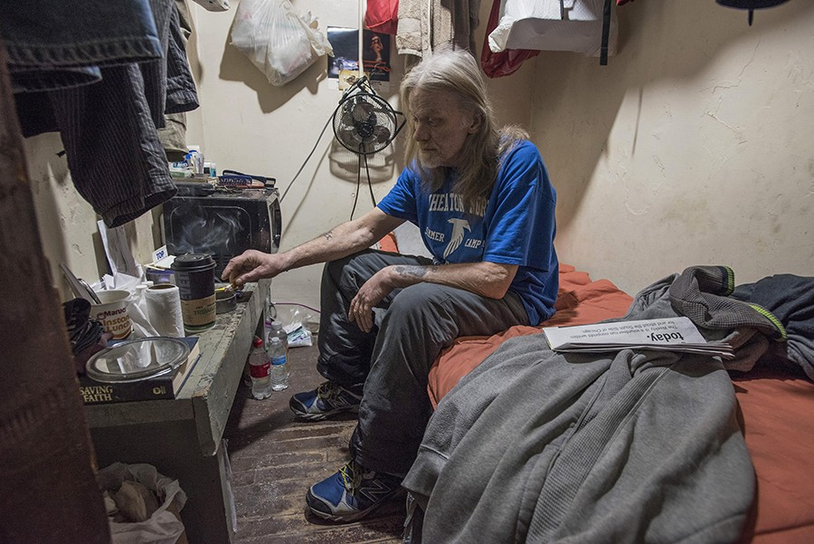 """Bob Boardman, an on-and-off 20-year resident at the hotel, in his room. """"If I didn't have this room I'd be sleeping on the streets somewhere. I've done that. I'd rather be here."""" - LLOYD DEGRANE"""