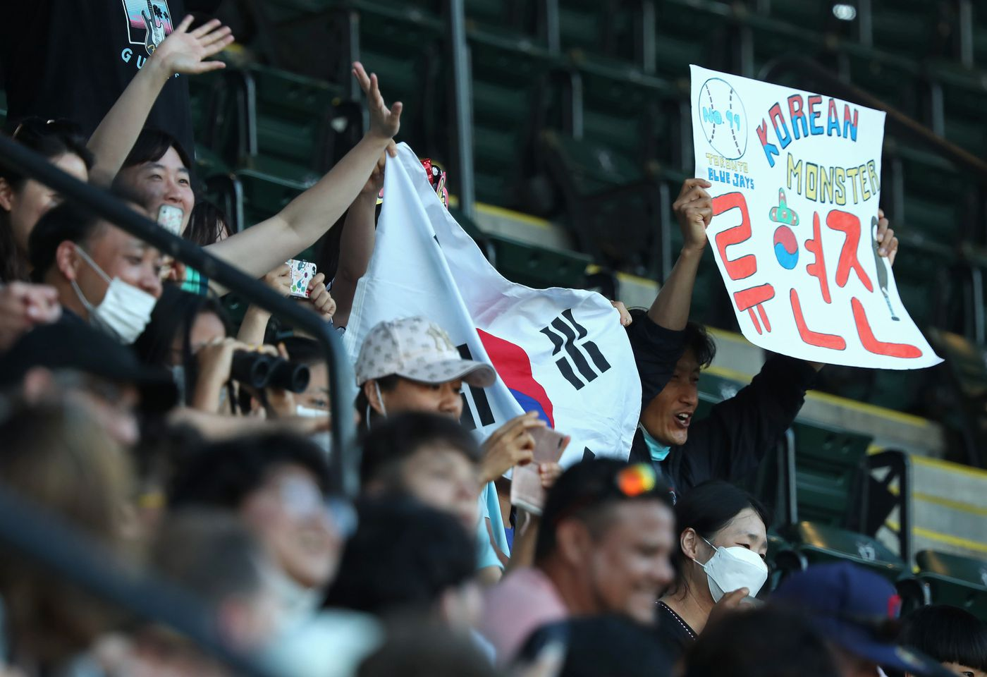 Fans of Blue Jays starting pitcher Hyun Jin Ryu hold up a Korean flag and a sign in the first inning against the White Sox on June 10, 2021, at Guaranteed Rate Field.