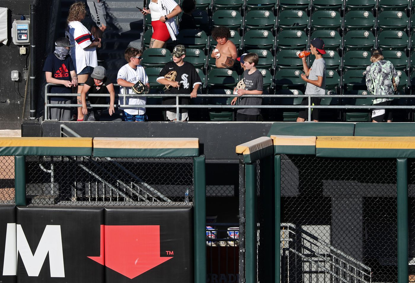 A young fan holds two baseballs as he and other young fans stand near the bullpen before a game between the White Sox and Blue Jays on June 10, 2021, at Guaranteed Rate Field.