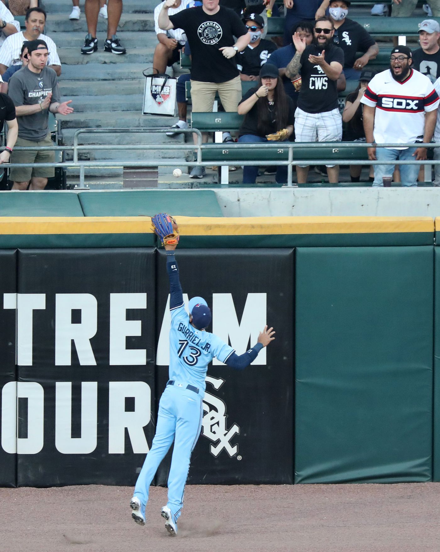 Blue Jays left fielder Lourdes Gurriel Jr. reaches for a ball off the bat of White Sox designated hitter Yermín Mercedes for a double in the first inning on June 10, 2021, at Guaranteed Rate Field.