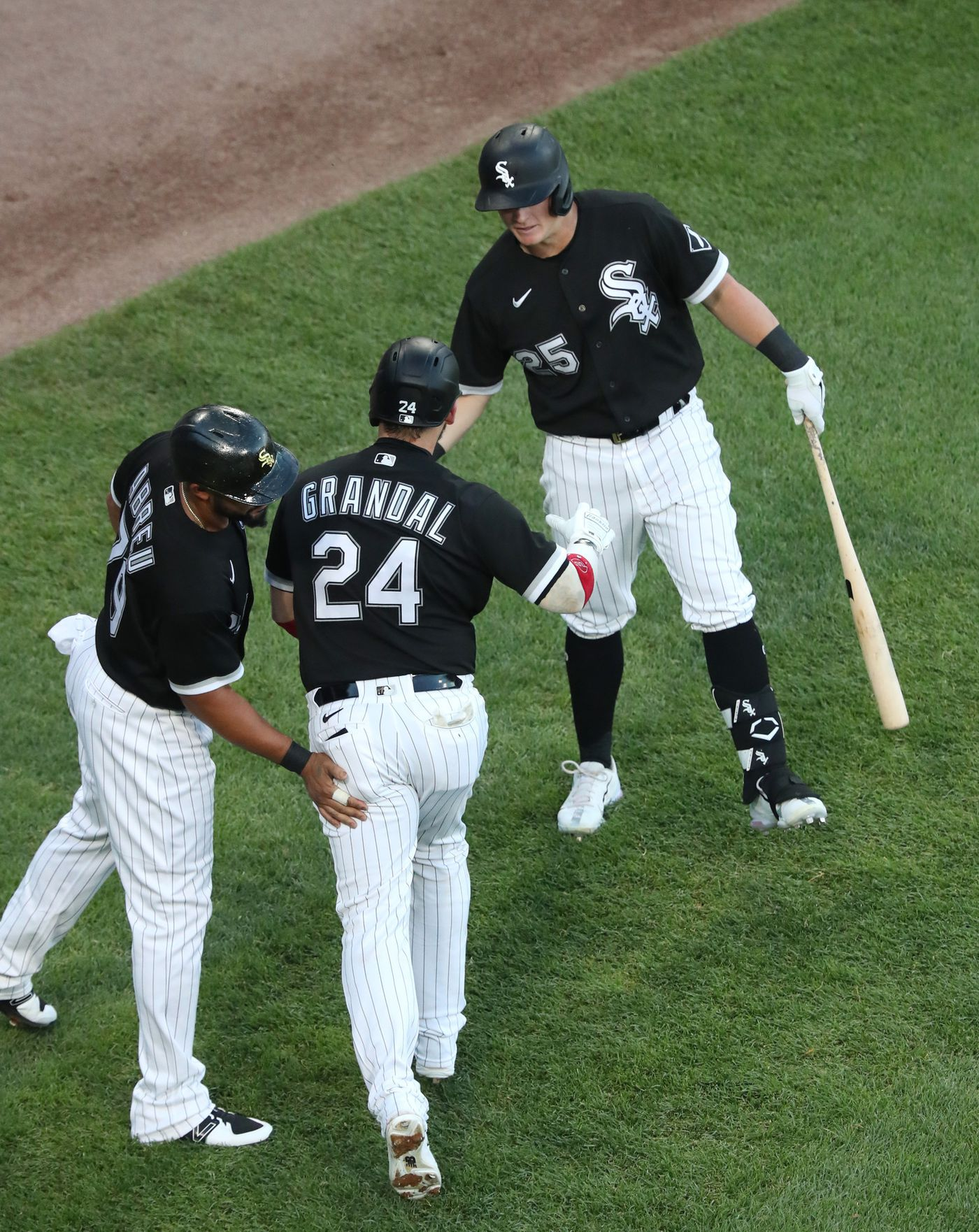 White Sox catcher Yasmani Grandal is congratulated by teammates after hitting a two-run home run in the first inning against the Blue Jays on June 10, 2021, at Guaranteed Rate Field.